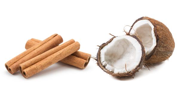 Image of cinnamon sticks and a coconut cut in half