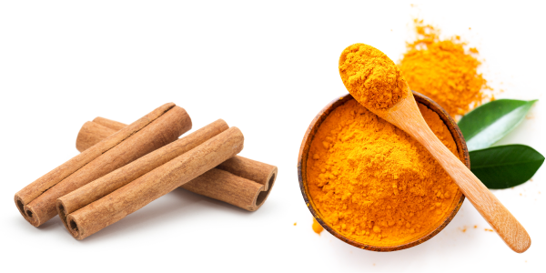 Picture of cinnamon sticks and powdered turmeric in a bowl
