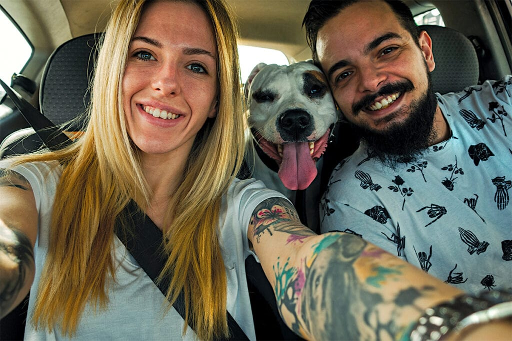 NewlA couple takes a selfie in the car with their newly adopted senior dog during Celebrate Pets in Shelters day