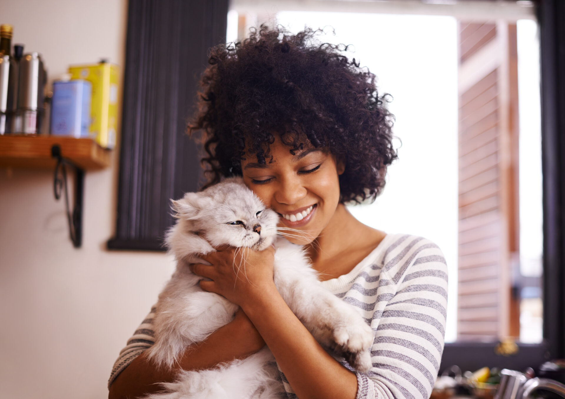 beautiful young woman showing love by enjoying a cuddle with her cat
