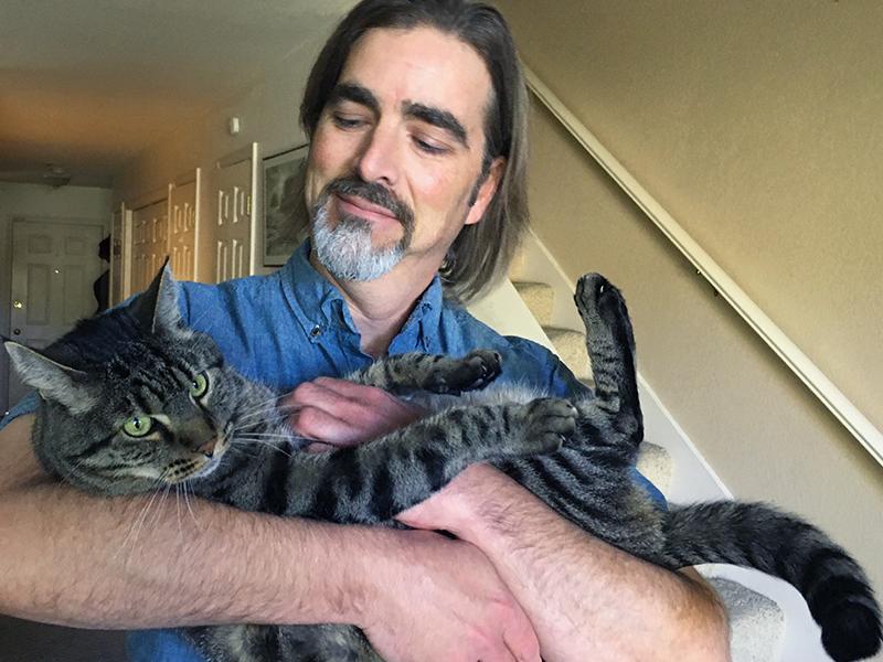 Leo the cat and Joe his pet parent C