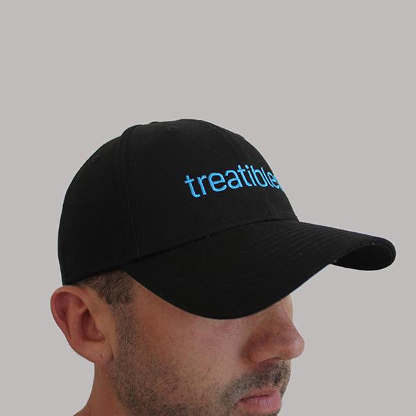 Emmet wearing Treatibles baseball cap