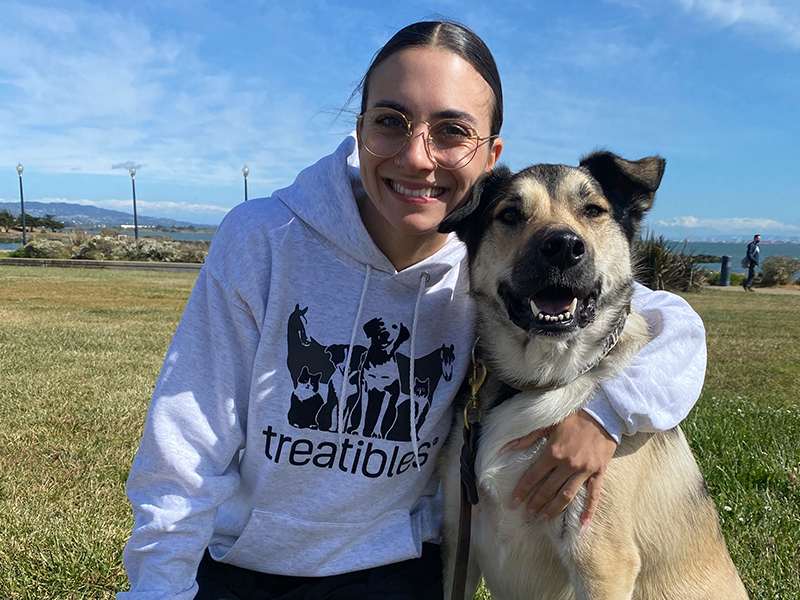 Image of Treatibles Brand Coordinator Dominique and her big smiley dog Sapper